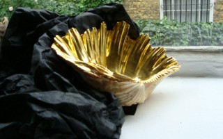 23.5 carat gold, gilded clam shell;