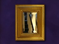 Water-gilded bevelled mirror with 23.5 carat yellow gold