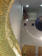 View through 23.5 carat gold, gilded section of 'Between', sculpture by Terry New, FRBS