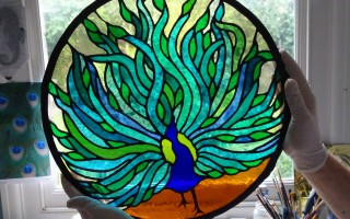 Peacock stained glass ready for cleaning and framing